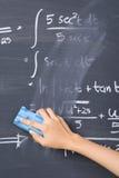 Hand cleaning blackboard Stock Photo