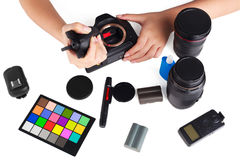 Hand cleaning a camera with cloth and photography equipment on white table. with clipping path Royalty Free Stock Images