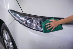 Hand cleaning car headlight 1 stock image