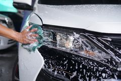 Hand cleaning car headlight 5 royalty free stock photography