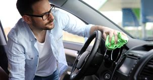 Hand cleaning car steering wheel with microfiber cloth. Cleaning car steering wheel with microfiber cloth Royalty Free Stock Photography