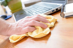 Hand cleaning desk at home Stock Image