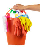 Hand with cleaning items Royalty Free Stock Image