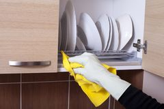 Hand cleaning kitchen sideboard Stock Photography