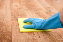 A hand cleaning parquet floor Stock Images