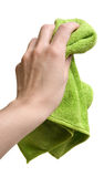 Hand with cleaning rag. A hand holding a green cleaning cloth isolated on white Royalty Free Stock Image