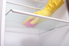 Hand cleaning refrigerator. Stock Images