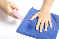 Hand cleaning with spray bottle and blue rag Stock Photo