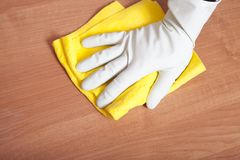 Hand cleaning table. Royalty Free Stock Photography