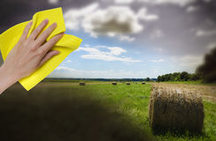 Hand cleaning turning dark day into sunny one Royalty Free Stock Photography