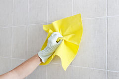 Hand cleaning wall. Royalty Free Stock Images