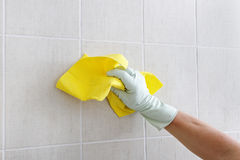 Hand cleaning wall. Stock Image