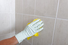 Hand cleaning wall. Royalty Free Stock Image