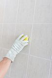 Hand cleaning wall. Royalty Free Stock Photography