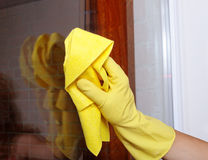 Hand cleaning window. Stock Photos