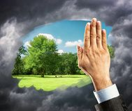 Hand cleaning window with blue sky Stock Image