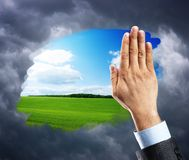 Hand cleaning window with blue sky Stock Photography