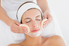 Hand cleaning woman's face with cotton swabs Royalty Free Stock Photography