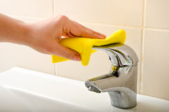 Hand cleans tap Royalty Free Stock Images