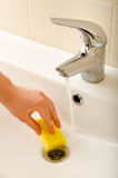 Hand cleans tap Royalty Free Stock Image