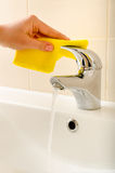 Hand cleans tap Royalty Free Stock Photography