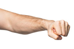 Hand with clenched a fist. Isolated on a white background Royalty Free Stock Images