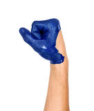 Hand is clenched into a fist painted in blue Stock Images