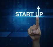 Hand click on start up icon over digital world map technology st Royalty Free Stock Photos