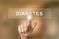 Hand clicking diabetes button on blurred background Stock Image