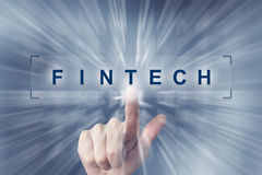 Hand clicking on fintech or Financial technology button Stock Photo