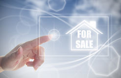 Hand clicking on house for sale Stock Photography