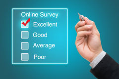 Hand clicking online survey on virtual screen Royalty Free Stock Image
