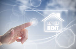 Hand clicking on rental house Stock Photo