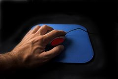 Hand clicking on a Scroll mouse. Picture of a hand clicking on a Scroll mouse (edited in PS stock photo