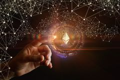 The hand clicks on ethereum. On a dark background royalty free stock images