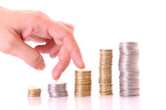 Hand Climbing Piles Of Money Stock Photos