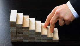 Hand climbing stairs made. By wooden blocks Stock Images