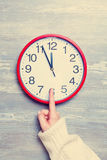 Hand and clock Royalty Free Stock Image