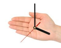 Hand with clock-hands Stock Images