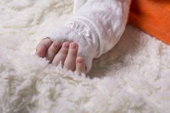 Hand close-up of a little baby girl on furry soft blanket.  Stock Photography