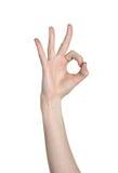 Hand close-up shows a gesture ok Stock Photos