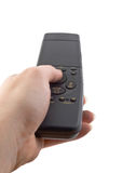 Hand with closed remote control Royalty Free Stock Photos