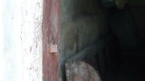 Hand closes and open old wooden door