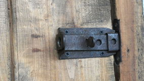Hand closes and open old wooden door stock video footage