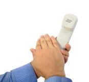 The hand closes phone tube Stock Photos