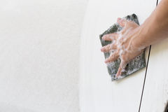 Hand with cloth cleaning dirty car Royalty Free Stock Photo