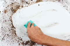 Hand with cloth cleans dirty surface Royalty Free Stock Images