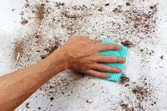 Hand with cloth cleans very dirty surface Royalty Free Stock Image