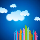 Hand with cloud computing symbol against blue sky. Stock Images