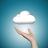 Hand with cloud icon. Blue background Stock Images